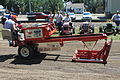 Tractor pulling sled.jpg