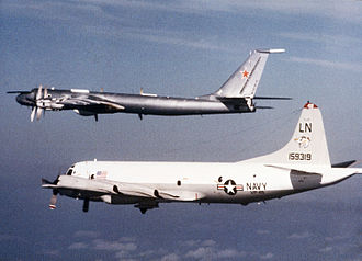 Tupolev Tu-142 - A Tu-142MK (with aft-facing fin-top fairing and smooth nose contour) being escorted by a US Navy Lockheed P-3 from VP-45 (March 1986)