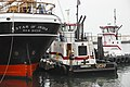 Tugs prepare to tow the Star of India.jpg