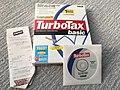 TurboTax Basic 2003 box disc and store receipt.jpg