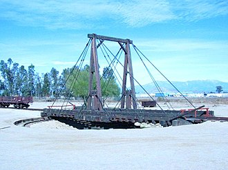 "Railway turntable - A small turntable at the Orange Empire Railway Museum in Perris, CA. This type of turntable with the central tower and supporting cables is called a ""gallows turntable"""