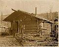 Two men in front of a log cabin in the Klondike, ca 1898 (MOHAI 7041).jpg