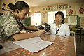 U.S. Army Capt. Sheila Swain, left, a medical officer, examines a patient during a cooperative health engagement (CHE) at Inhobol Elementary School in Masinloc, Zambales province, Philippines, April 5, 2013 130405-M-UY788-067.jpg