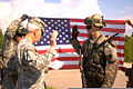 U.S. Army Maj. Gen. Wesley E. Craig, left foreground, the Pennsylvania adjutant general, administers the oath of enlistment to Staff Sgt. Justin Bakow during a re-enlistment ceremony June 7, 2013, in Adazi 130607-Z-ZZ999-513.jpg