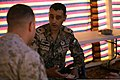 U.S. Marine Corps Capt. Joseph J. Endreola, left, the assistant civil-military operations planner with Marine Corps Forces Central Command (Forward), speaks with Royal Jordanian Army 2nd Lt. Zayed Alkhwalden 130609-M-UV027-119.jpg