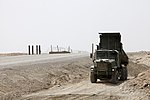 U.S. Marine Corps Lance Cpl. Wesley J. Henkel, a motor transport operator with Marine Wing Support Squadron (MWSS) 271, drives a medium tactical vehicle replacement at Camp Bastion, Helmand province 130807-M-SA716-095.jpg