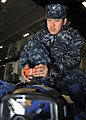 U.S. Navy Aviation Boatswain's Mate (Handling) 3rd Class Dionisio Caguioa replaces the batteries in a distress marker light aboard the aircraft carrier USS Nimitz (CVN 68) 130131-N-TR165-013.jpg