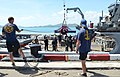 U.S. Sailors assigned to Mobile Diving and Salvage Unit 1 and Thai sailors hoist a portable hyperbaric chamber during a dive medicine scenario support of Cooperation Afloat Readiness and Training (CARAT) 2013 130610-N-YU572-347.jpg