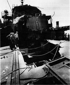 USS Pinkney (APH-2) - Viewing the damage, with electrical cables and hoses from support ships across the hole.