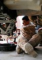 US Army 52575 Sgt. John D. Pumphrey, a truck commander from Columbus, Miss., uses his time-off Sept. 30 to help replace the rear brakes on his High Mobility, Multipurpose Vehicle. Pumphrey is member of 1st Platoon.jpg