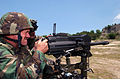 US Navy 030414-N-6501M-036 Master Chief Boatswain Mate Michael D. Bloom Command Master Chief for the Joint Special Operation Task Force - Philippines (JSOTF-P) fires a Mark-19, 40mm grenade launcher.jpg