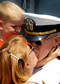 US Navy 030630-N-1512S-242 Lt. Michael Bobinger from Cinncinati, Ohio kisses his wife as his son looks on.jpg