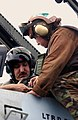 US Navy 031020-N-9411J-006 A squadron crewmember helps strap Photographer's Mate 1st Class Edward Berard, from Lompoc, Calif., into an F-A-18F Super Hornet.jpg