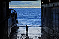US Navy 040719-N-8500S-002 Boatswain's Mate 1st Class Douglas Perry, looks out at the Island of Oahu from the well-deck of the amphibious assault ship USS Tarawa (LHA 1) during exercise Rim of the Pacific (RIMPAC) 2004.jpg