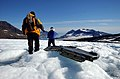 US Navy 040809-N-0331L-005 Lt. Cmdr. Christopher Blow, right, and Lt. Cmdr. Steve Dial examine the wreckage of a Navy P-2V Neptune aircraft that crashed over Greenland in 1962.jpg
