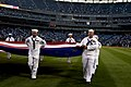 US Navy 040901-N-5576W-009 Chief petty officer selectees assigned to various commands aboard Naval Station Great Lakes, Ill., parade an American flag at Cellular Field.jpg