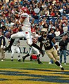 US Navy 041120-N-9693M-006 Rutgers University tight end Clark Harris catches a pass from quarterback Ryan Hart under coverage by U.S. Naval Academy Midshipman 3rd Class Hunter Reddick.jpg