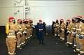 US Navy 041207-N-4584T-024 Damage Controlman 3rd Class Thomas Kwiecinski inspects members of the fire team to ensure proper fire dress during a general quarters (GQ) drill.jpg