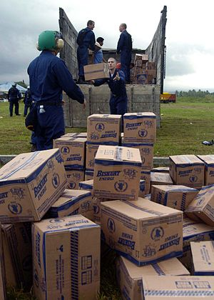 Humanitarian response to the 2004 Indian Ocean earthquake - Sailors of USS ''Abraham Lincoln'' prepare for aerial resupply drops by US helicopters.