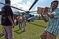 US Navy 050123-N-9885M-250 Indonesian citizens carry boxes of noodles from a MH-53E Sea Dragon helicopter as air crewmen offload relief supplies in Lamno, Indonesia.jpg