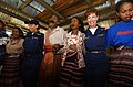 US Navy 050328-N-6665R-281 Cmdr. Karen McDonald and Hospital Corpsman 3rd Class Judith Quintana dance with members of the Apui Village during a celebration for the medical team.jpg