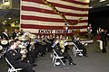 US Navy 050703-N-0167B-028 The Royal Australian Navy band provides a live performance in the hangar bay of the conventionally powered aircraft carrier USS Kitty Hawk (CV 63).jpg