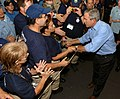 US Navy 050915-N-5345W-147 President George W. Bush meets relief organization personnel, along with Sailors and Soldiers after returning to the amphibious assault ship USS Iwo Jima (LHD 7).jpg