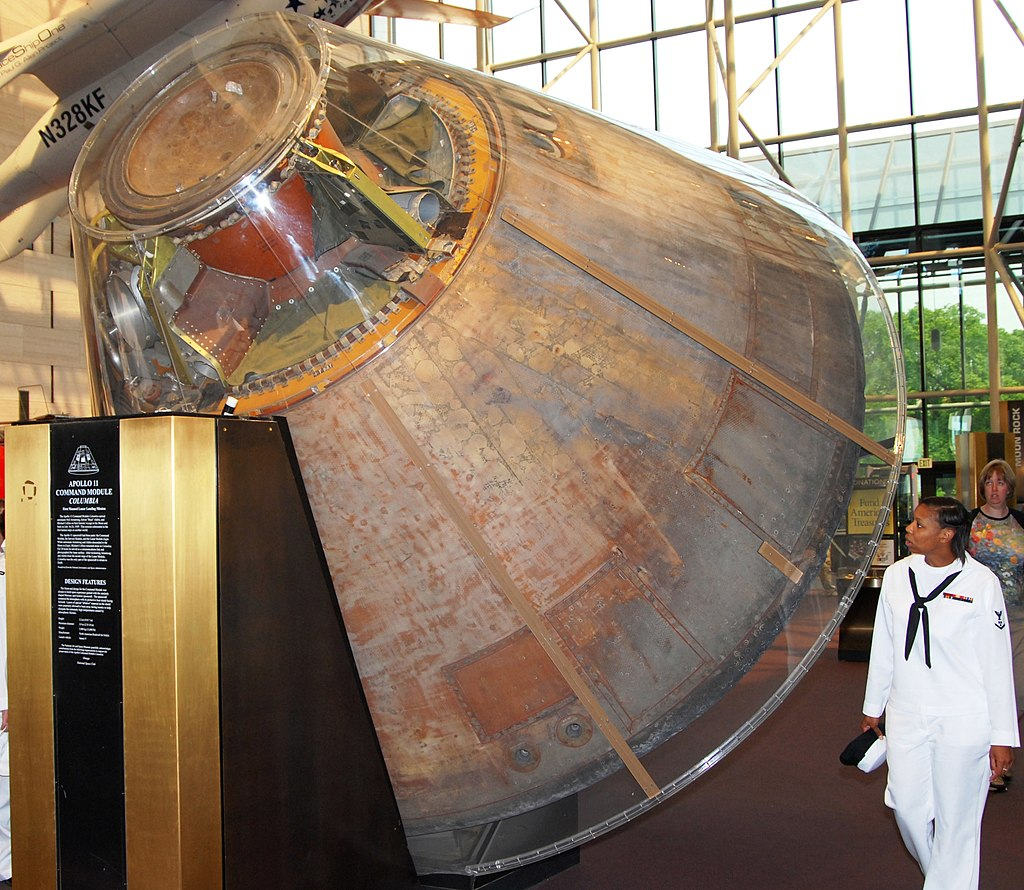 US Navy 070516-N-6724S-049 Machinist's Mate 3rd Class Davida Edwards examines the Apollo 11 Command Module in the lobby of the National Air and Space Museum
