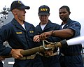 US Navy 070718-N-4163T-068 Damage Controlman 3rd Class Jason Chatman instructs midshipmen on the proper way to relieve the nozzelman on a firefighting hose.jpg