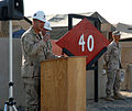 US Navy 070809-N-3768T-006 Cmdr. G.W. Harshberger, commanding officer of Naval Mobile Construction Battalion (NMCB) 40, addresses the group of Seabees after receiving the transfer of authority from NMCB-133 during a ceremony at.jpg