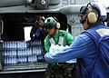 US Navy 070907-N-7540C-042 Sailors from the multi-purpose amphibious assault ship USS WASP (LHD 1), load bottled water and Meals Ready to Eat (MRE) into an MH-60S Seahawk helicopter during disaster relief efforts in Nicaragua.jpg