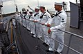 US Navy 070929-N-2781V-001 Sailors assigned to submarine tender USS Emory S. Land (AS 39) man the rails as the ship pulls out of her homeport in Italy for the final time.jpg