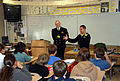 US Navy 071001-N-3090M-001 Lt. Christopher Shutt, right, and Lt. Chris Sova, Sailors aboard the USS Texas (SSN 775), speak with math students at Cutler Middle School about the importance of math in the daily lives of submariner.jpg