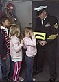 US Navy 071019-N-0483B-006 Chief Damage Controlman Ted Leavitt shows a group of children how a Naval Firefighting Thermal Imager (NFTI) works during a Friends and Family Day Cruise.jpg