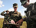 US Navy 081010-N-0411D-008 Equipment Operator Constructionman Jose Torres, right, plots a point on a map with Ens. Jennifer Knop at the beginning of a land navigation exercise during a Navy Expeditionary Combat Skills School tr.jpg