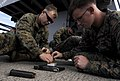 US Navy 091113-N-7280V-300 Lance Cpl. Joshua Jerkins, Cpl. Michael Jeffers and Lance Cpl. Daniel Wheeler load 9mm magazines.jpg