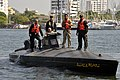 US Navy 091205-N-8273J-220 Chief of Naval Operations (CNO) Adm. Gary Roughead drives a semi-submersible boat while meeting with Colombian Coast Guard Forces at Naval Base Bolivar.jpg