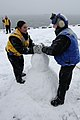 US Navy 100129-N-0080L-209 Sailors build a snowman aboard USS Kearsarge.jpg