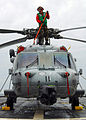 US Navy 100130-N-7058E-108 Sailor cleans a MH-60S helicopter aboard USS Freedom.jpg