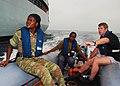 US Navy 100320-N-6138K-347 Belgian navy Cpl. Eddy Destaelen teaches Benin navy Quartermasters Seaman Chimene Djimahloue and Seaman Ahyi Ariane how to navigate a zodiac boat.jpg