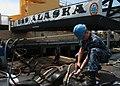 US Navy 100415-N-9753W-078 Electronics Technician 3rd Class Billy Dodson uses a needle gun during maintenance on the hull of the Ohio-class ballistic-missile submarine USS Alaska (SSBN 732).jpg