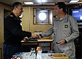 US Navy 100422-N-3542S-064 Capt. Aaron C. Jacobs and Cmdr. Eduardo A. Wieland ), exchange coins aboard the Brazilian Navy frigate BNS Independencia (F44).jpg