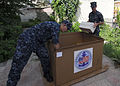 US Navy 100617-N-7638K-067 Sailors assigned to the guided-missile frigate USS Taylor (FFG 50) unload boxes of donated supplies from Project Handclasp to the Ledi Diana Pediatric Clinic.jpg
