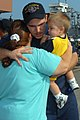 US Navy 100827-N-5292M-026 Machinist Mate 3rd Class Bobby Outen hugs his family before boarding the amphibious transport dock ship USS Ponce (LPD 15) as the ship prepares to depart Naval Station Norfolk.jpg