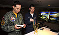 US Navy 101203-N-7103C-028 Yeoman Seaman Kevin Tucker, from Quaker Town, Penn., lights the Menorah during the third day of Hanukkah while Lt. Cmdr.jpg