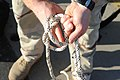 US Navy 110128-N-2943C-072 A helicopter rope suspension technique cast master trains students to tie knots during Explosive Ordnance Disposal (EOD).jpg