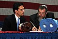 US Navy 110313-N-TB177-135 U.S. Rep. Eric Cantor, left, observes as a Torah scroll is dedicated by Rabbi Joshua Sherwin during a ceremony in the ha.jpg