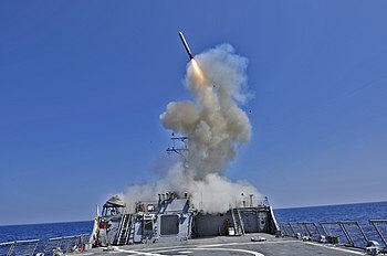 US Navy 110329-N-XO436-010 The Arleigh Burke-class guided-missile destroyer USS Barry (DDG 52) launches a Tomahawk cruise missile to support Joint.jpg