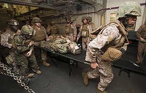 US Navy 111209-N-PB383-225 Hospital corpsmen assigned to the 11th Marine Expeditionary Unit (11th MEU) transport simulated casualties in the well d.jpg