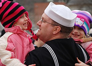 US Navy 111214-N-AW342-132 Sonar Technician Submarine 1st Class Patrick Fonner spends his first moments back from deployment with daughters, Rebecc.jpg